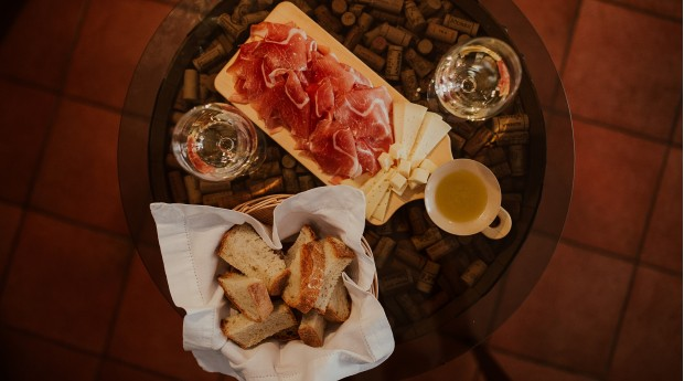 Wine, olive oil, Karst cured ham and cheese